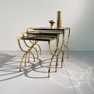 3 brass nesting tables with smoked glass shelves Maison Jansen_0